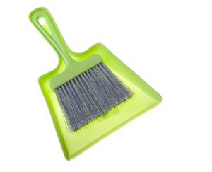 green dustpan and brush isolated on white background