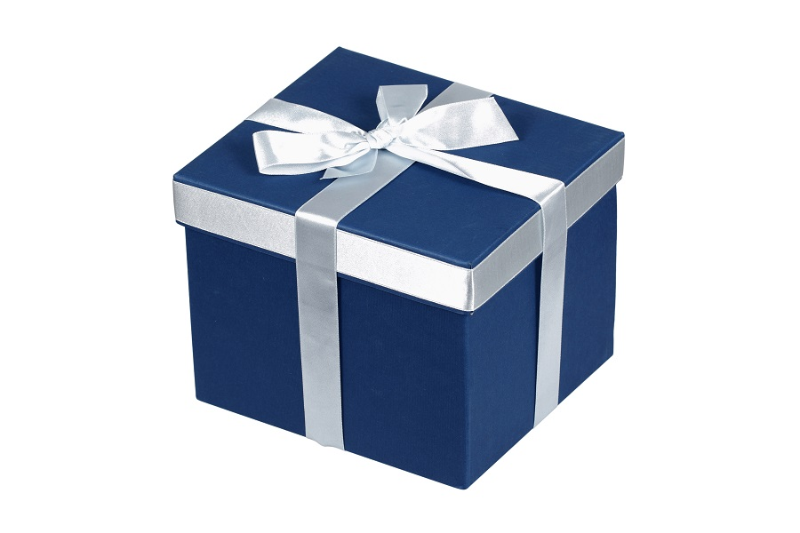 Blue gift box with silver ribbon over white with clipping path.
