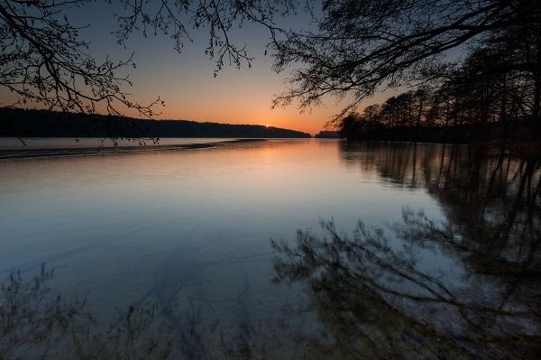 Beautiful, mystic sunrise over lake. Summertime in Mazury lake district.