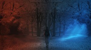A woman walks along a path and makes a decision which way to go.